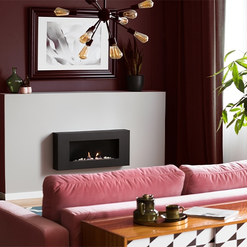 Rich tone living room with deep cherry walls and dark pink couch